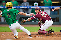 Florida State Seminoles catcher Cal Raleigh (35) reaches for the throw as Jake Shepski (0) of the Notre Dame Fighting Irish begins his slide into home plate during Game Four of the 2017 ACC Baseball Championship at Louisville Slugger Field on May 24, 2017 in Louisville, Kentucky.  The Seminoles walked-off the Fighting Irish 5-3 in 12 innings. (Brian Westerholt/Four Seam Images)