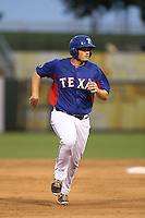 Zach Stephens #8 of the AZL Rangers runs the bases during a game against the AZL Cubs at Surprise Stadium on July 6, 2014 in Surprise, Arizona. AZL Rangers defeated the AZL Cubs, 7-5. (Larry Goren/Four Seam Images)