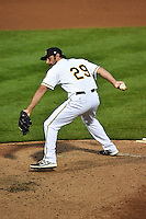 Kurt Spomer (29) of the Salt Lake Bees delivers a pitch to the plate against the Albuquerque Isotopes at Smith's Ballpark on April 21, 2014 in Salt Lake City, Utah.  (Stephen Smith/Four Seam Images)