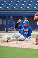 GCL Mets center fielder Guillermo Granadillo (90) slides home during the second game of a doubleheader against the GCL Nationals on July 22, 2017 at The Ballpark of the Palm Beaches in Palm Beach, Florida.  GCL Mets defeated the GCL Nationals 4-1.  (Mike Janes/Four Seam Images)
