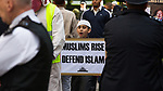 "© Joel Goodman - 07973 332324 . 11/09/2011 . London , UK . A boy holding a placard that reads "" Muslims Rise Defent Islam "" . Islamist organisation Muslims Against Crusades hold a demonstration outside the American Embassy in London on the tenth anniversary of Al-Qaeda's terrorist attack on the World Trade Centre in New York . Photo credit : Joel Goodman"