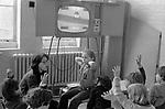 Primary school children watching TV schools TV 1970s London.