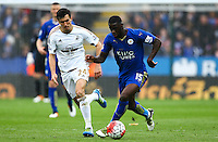 Jack Cork of Swansea City and Jeff Schlupp of Leicester City during the Barclays Premier League match between Leicester City and Swansea City played at The King Power Stadium, Leicester on 24th April 2016
