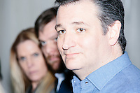 Texas senator and Republican presidential candidate Ted Cruz speaks to the media before a town hall at The Alpine Grove banquet center in Hollis, New Hampshire.