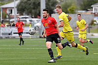 Ihaia Delaney of Canterbury United competes for the ball with Finn Surman of the Wellington Phoenix during the ISPS Handa Men's Premiership - Wellington Phoenix Reserves v Canterbury United at Fraser Park, Wellington on Saturday 9 January 2021.<br /> Copyright photo: Masanori Udagawa /  www.photosport.nz