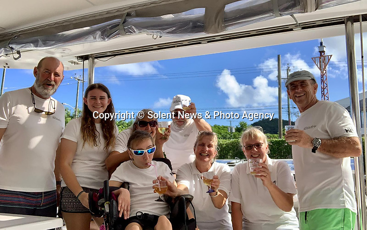 Pictured:  Natasha Lambert surrounded by friends and family after completing her epic voyage.<br /> <br /> A young woman with cerebral palsy has sailed 3,000 miles across the Atlantic ocean in just 18 days - using only her mouth and tongue to control the boat.<br /> <br /> Natasha Lambert, 23, used the 'sip and puff' system engineered by her electrician father to sail from Gran Canaria on the Western coast of Africa to St Lucia in the Caribbean.<br /> <br /> The trip, which hoped to raise £30,000 for three charities, took 18 days, 24 hours, 29 minutes and eight seconds to complete.   SEE OUR COPY FOR DETAILS.<br /> <br /> © Solent News & Photo Agency<br /> UK +44 (0) 2380 458800