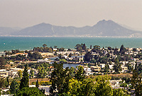 Carthage, Tunisia.  Punic Ports, now resembling small lakes  bordered by luxurious homes, date from the 4th. Century B.C.  Bay of Tunis and the extinct volcano known as Bou Kornein are in the background.