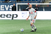 FOXBOROUGH, MA - OCTOBER 7: Laurent Ciman #26 of Toronto FC looks to pass during a game between Toronto FC and New England Revolution at Gillette Stadium on October 7, 2020 in Foxborough, Massachusetts.