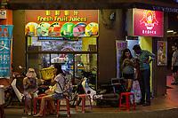 Tourists Using Cell Phones at Night, Jonker Street, Melaka, Malaysia.