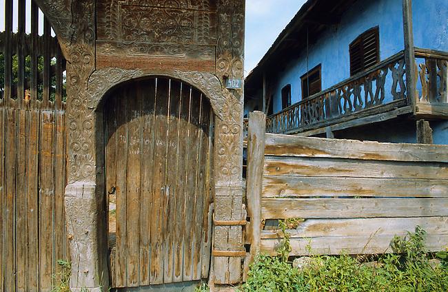 Ornamental carved wood Szekely village farm gate. Transylvania, Romania.