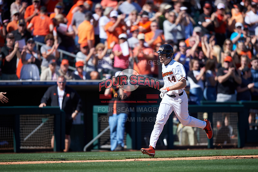 Oregon State Beavers Alex McGarry (44) rounds the bases after hitting a home run during an NCAA game against the New Mexico Lobos at Surprise Stadium on February 14, 2020 in Surprise, Arizona. (Zachary Lucy / Four Seam Images)