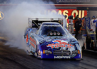 Apr 7, 2006; Las Vegas, NV, USA; NHRA Funny Car driver Whit Bazemore does a burnout in his Matco Tools Dodge Charger during qualifying for the Summitracing.com Nationals at Las Vegas Motor Speedway in Las Vegas, NV. Mandatory Credit: Mark J. Rebilas