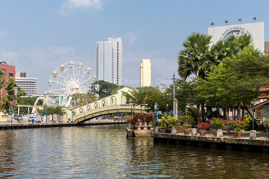 Melaka River and Riverwalk, Melaka, Malaysia.  Pedestrian Bridge and Ferris Wheel.