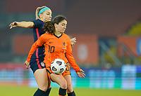 BREDA, NETHERLANDS - NOVEMBER 27: Daniëlle van de Donk #10 of the Netherlands battles  Julie Ertz #8 of the United States during a game between Netherlands and USWNT at Rat Verlegh Stadion on November 27, 2020 in Breda, Netherlands.