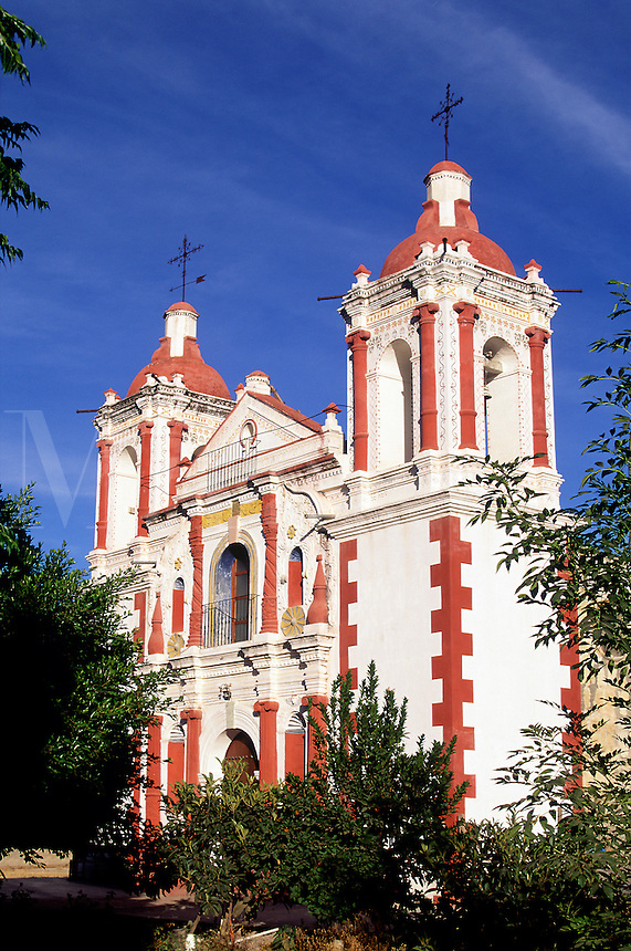 Church of Santa Ana del Valle, white with red trim, blue sky.#7149. Santa Ana del Valle Oaxaca Mexico.