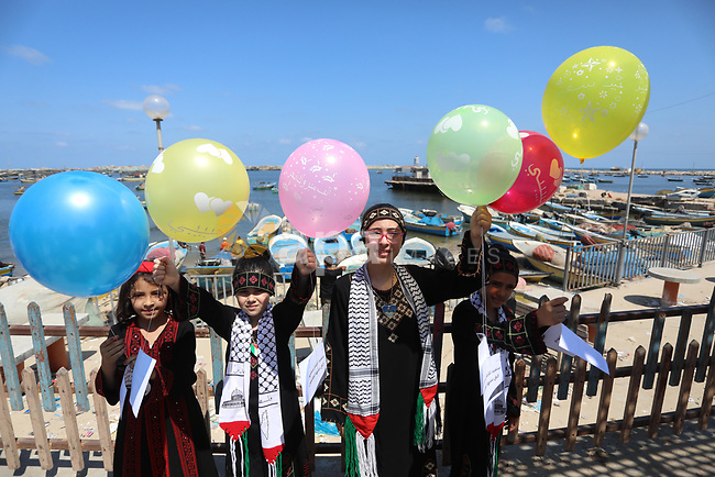 Palestinian orphans take part in a rally demanding their rights, in Gaza seaport, on August 10, 2021. The fiscal position in Gaza strip has worsened not only due to the outbreak but also due to a political standoff that is disrupting the flow of revenues. The outlook remains precarious and subject to numerous political, security and health risks. Photo by Ashraf Amra