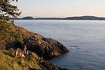 Couple, sea kayak camping, Strawberry Island, San Juan Islands, Puget Sound, Salish Sea, Washington State, U.S.A., Washington State Department of Natural Resources, Cypress Island Natural Resources Conservation Area,.model released,.
