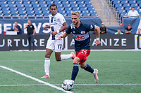 FOXBOROUGH, MA - JULY 4: Pierre Cacet #44 of the New England Revolution II brings the ball forward during a game between Greenville Triumph SC and New England Revolution II at Gillette Stadium on July 4, 2021 in Foxborough, Massachusetts.
