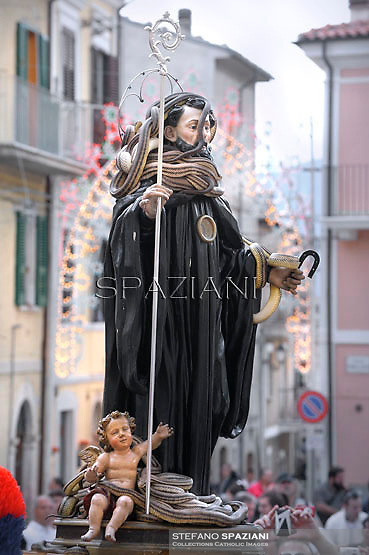 """A statue of Saint Domenico surrounded by live snakes is held up by worshippers during an annual procession dedicated to the saint, in the streets of Cocullo, in the Abruzzo region, on May 1, 2012...The St. Domenico's procession in Cocullo, central Italy. Every year on the first  of May, snakes are placed onto the statue of St. Domenico and then the statue is carried in a procession through the town. St. Domenico is believed to be the patron saint for people who have been bitten by snakes:..Italy, Cocullo, in the Province of L'A...quila, is at 870 meters a.s.l., along the railway line connecting Sulmona to Rome. The village rises alongside Mount Luparo (1327 meters) """"The valley opening in front of the village is surrounded by bare rocks, while on the other side, to the south, snow-capped mountain crests follow one after the other..."""".San Domenico Abate lived in the 10th and 11th centuries AD. Born in Foligno, in the Umbria region, he started his pilgrimages, preaching and ascetic practices in Central Italy, making miracles recorded by the word-of-mouth tradition. He died on 22 January 1031 and was buried in Sora...Cocullo snake charmers are over with their snake hunting. They proceeded through the During the procession on the first in May, before the snakes are placed all over the statue of St. Dominick, they will be fed with milk kept in containers with crusca. It is the snake that, most of all other elements, expresses an ancestral myth: the unknown aspect and unpredictability of the natural environment with man's innate need to achieve the dominance on his own habitat. ..Snakes and wolves were the emblems of Italic peoples like the Marsians and Irpinians. Some areas in Abruzzo, especially in the Sagittario valley, were under the menace of wolves and snakes, which for the local populations represented the uncertainty and anxiety of their existence that, together with the precariousness and hardships of life, were almost unbearable. Therefore the community adopted s"""
