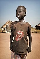 Young boy with a Rolling Stones t-shirt in a rural area outside Juba. Central Equatoria, South Sudan.