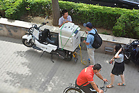 """""""What could possibly go wrong?"""" Putting a heavy photocopier on a scooter. Did it get to its destination?"""