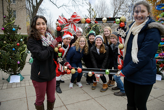 """December 1, 2016; """"Howard Halliday,"""" an event sponsored by Howard Hall featuring cookies and hot chocolate as well as a Christmas tree decorating competition between dorms. The event on Fieldhouse Mall is also a fundraiser for charity through purchasing votes for the best tree. (Photo by Matt Cashore/University of Notre Dame)"""