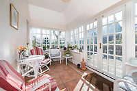BNPS.co.uk (01202) 558833. <br /> Pic: SandersonYoung/BNPS<br /> <br /> Porch.<br /> <br /> A quirky 'show home' for a brickwork owner where Lewis Carroll is believed to have stayed while writing some of his Alice in Wonderland books is on the market for just under £1m.<br /> <br /> Red Cottage is a striking Grade II listed property in Whitburn, Tyne and Wear, where Charles Dodgson, otherwise known as Lewis Carroll, regularly visited family.<br /> <br /> The unusual 179-year-old home was built to show off as many design features as possible, and has a walled garden and even an air raid shelter.