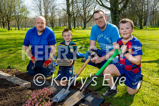 Enjoying some planting in the Listowel town park on Good Friday, l to r: Christopher Curran, Darren and Tom O'Connor and Kyle Curran.