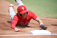 Philadelphia Phillies Bryson Stott (10) slides head first into third base during an Instructional League game against the Toronto Blue Jays on September 27, 2019 at Englebert Complex in Dunedin, Florida.  (Mike Janes/Four Seam Images)