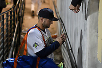 Left fielder Tim Tebow (15) of the Columbia Fireflies signs an autograph after his first Class A game against the Augusta GreenJackets on Opening Day, Thursday, April 6, 2017, at Spirit Communications Park in Columbia, South Carolina. (Tom Priddy/Four Seam Images)