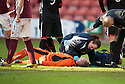 Stenny goalkeeper Chris Smith lies flat out after being knocked out by Pars' Callum Morris.