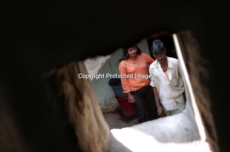 INDIA (West Bengal - Calcutta) -A sex worker waits in a lane while a customer passes by. Kolkata, India- Arindam Mukherjee