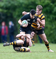 Saturday 18th February 2017 | CCB vs RBAI<br /> <br /> Oscar Yandall is tackled by Sam Fryers and Joe Finnegan during the Ulster Schools' Cup Quarter Final clash between Campbell College Belfast and RBAI at Foxes Field, Campbell College, Belmont, Belfast, Northern Ireland.<br /> <br /> Photograph by John Dickson | www.dicksondigital.com