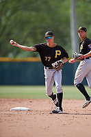 Pittsburgh Pirates shortstop Andrew Walker (77) throws to first base to try to complete a double play during a minor league Extended Spring Training intrasquad game on April 1, 2017 at Pirate City in Bradenton, Florida.  (Mike Janes/Four Seam Images)