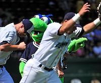 """15 July 2010: Vermont Lake Monsters' mascot """"Champ"""" entertains the fans as the team takes to the field at a game against the Aberdeen IronBirds at Centennial Field in Burlington, Vermont. The Lake Monsters rallied in the bottom of the 9th inning to defeat the IronBirds 7-6 notching their league leading 20th win of the 2010 NY Penn League season. Mandatory Credit: Ed Wolfstein Photo"""