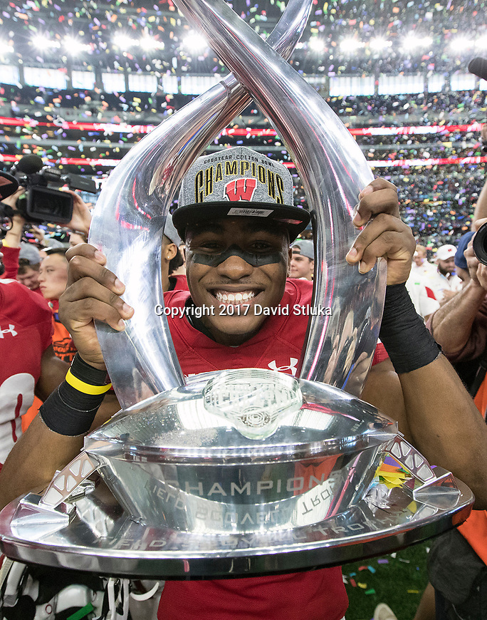 Wisconsin Badgers defensive back Sojourn Shelton (8) celebrates with the trophy after the 2017 NCAA Cotton Bowl football game against the Western Michigan Broncos Tuesday, January 2, 2017, in Irving, Texas. The Badgers won 24-16. (Photo by David Stluka)