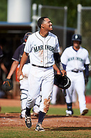Seattle Mariners Rayder Ascanio (5) reacts after catcher Johan Quevedo (not shown) jokingly flipped him the ball after being tagged out at home during an instructional league intrasquad game on October 6, 2015 at the Peoria Sports Complex in Peoria, Arizona.  (Mike Janes/Four Seam Images)