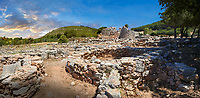 Pictures and image of the exterior ruins of Palmavera prehistoric round walled Nuragic village houses with its Nuraghe tower behind, archaeological site, middle Bronze age (1500 BC), Alghero, Sardinia.