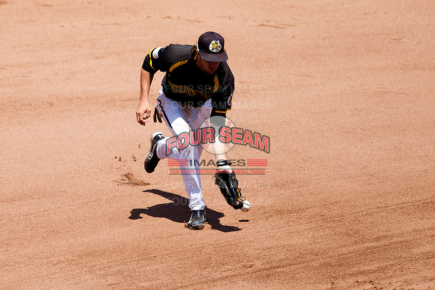 Erik Harbutz (38) of the Wichita State Shockers misplays a ball hit to the left side during a game against the Missouri State Bears in the 2012 Missouri Valley Conference Championship Tournament at Hammons Field on May 23, 2012 in Springfield, Missouri. (David Welker/Four Seam Images)
