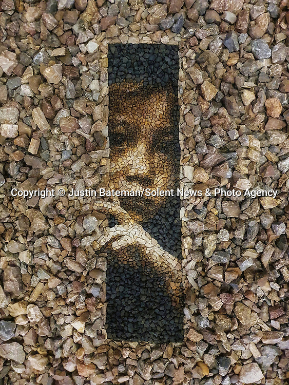 Pictured:   'Refugee'. Created using found stones. Chiang Mai, Thailand.  Inspired by a photograph of Burmese Refugees in Thailand, with the kind permission of Christian Bobst.<br /> <br /> A British artist stuck in Thailand has spent his time constructing masterpieces from pebbles for locals to enjoy.  Justin Bateman had only planned on staying in Chiang Mai for a week - but has remained there now for nearly ten months after the pandemic struck. <br /> <br /> His pebble portraits include The Queen, Spanish painter Pablo Picasso, Michelangelo's David and a local farmer - who was bemused by his portrait.   Mr Bateman, from Portsmouth, Hants, was staying in Bali when he travelled to Chiang Mai, in Thailand, to visit some friends.   SEE OUR COPY FOR DETAILS.<br /> <br /> Please byline: Justin Bateman/Solent News<br /> <br /> © Justin Bateman/Solent News & Photo Agency<br /> UK +44 (0) 2380 458800