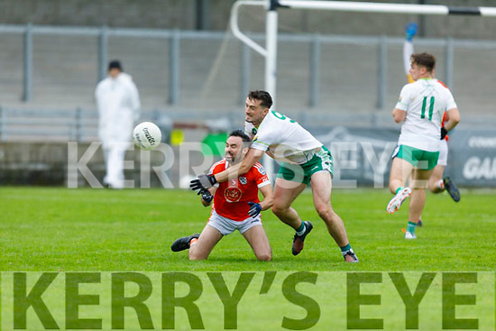 Brosna's Thomas Fitzgerald been tightly marked by  Ballydonoghue's Micheál Foley in the Premier Junior Football Championship Semi-Final