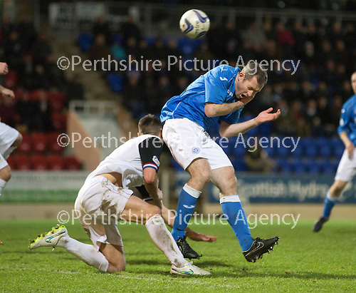 St Johnstone v Inverness Caledonian Thistle...20.12.14   SPFL<br /> Frazer Wright takes a sore one<br /> Picture by Graeme Hart.<br /> Copyright Perthshire Picture Agency<br /> Tel: 01738 623350  Mobile: 07990 594431