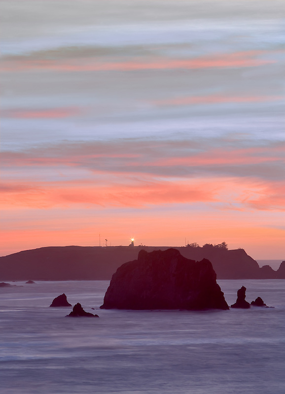 Sunset off Blacklock Point with Cape Blanco lighthouse. Oregon