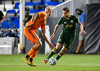 LAKE BUENA VISTA, FL - JULY 18: Diego Valeri #8 of the Portland Timbers is defended by Aljaz Struna #5 of the Houston Dynamo during a game between Houston Dynamo and Portland Timbers at ESPN Wide World of Sports on July 18, 2020 in Lake Buena Vista, Florida.