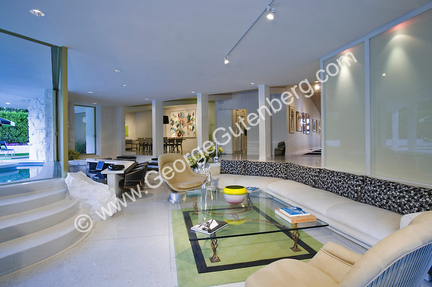 Contemporary living room with view of dining room and bar in background