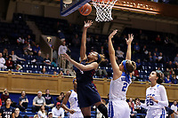 DURHAM, NC - NOVEMBER 29: Kennedy Suttle #4 of the University of Pennsylvania takes a layup over Haley Gorecki #2 of Duke University during a game between Penn and Duke at Cameron Indoor Stadium on November 29, 2019 in Durham, North Carolina.