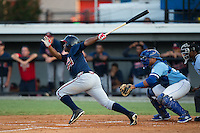 Ronald Acuna (11) of the Danville Braves follows through on his swing against the Burlington Royals at Burlington Athletic Park on August 13, 2015 in Burlington, North Carolina.  The Braves defeated the Royals 6-3. (Brian Westerholt/Four Seam Images)