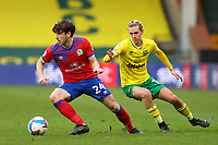 20th March 2021; Carrow Road, Norwich, Norfolk, England, English Football League Championship Football, Norwich versus Blackburn Rovers; Joseph Rankin-Costello of Blackburn Rovers takes on Todd Cantwell of Norwich City