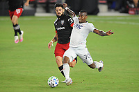 WASHINGTON, DC - AUGUST 25: Teal Bunbury #10 of New England Revolution battles for the ball with Junior Moreno #5 of D.C. United during a game between New England Revolution and D.C. United at Audi Field on August 25, 2020 in Washington, DC.