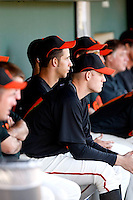 Madison Bumgarner (left) and Tim Alderson on the bench at a Giants-Padres spring training game at Scottsdale Stadium, March 14, 2009. Bumgarner and Alderson are the Giants top two pitching prospects..Photo by:  Bill Mitchell/Four Seam Images